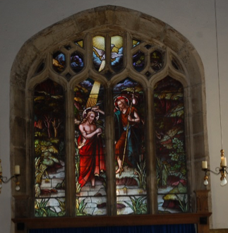 photo showing Stained glass window on the west wall of the church