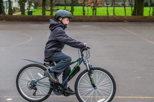 Photo of boy riding bikeability bike